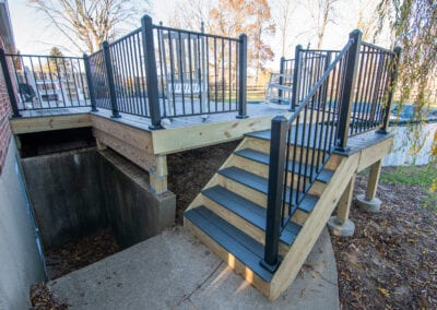 Black Wood stairs with iron fenced Deck Modeling