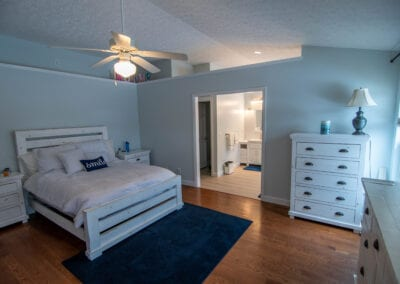 White colored bedroom with mat