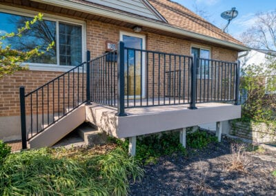 Cream Colored and Iron Fenced Deck Modeling